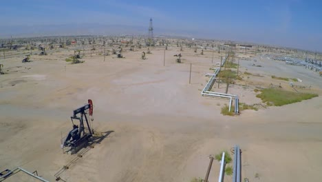 Amazing-aerial-shot-over-vast-oil-fields-and-derricks-near-Bakersfield-California-4