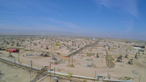 Amazing-aerial-shot-over-vast-oil-fields-and-derricks-near-Bakersfield-California-5