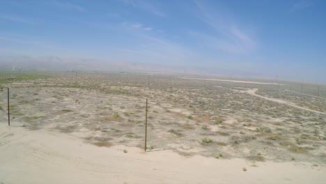 A-good-aerial-shot-over-an-oil-pumping-derrick-near-Bakersfield-California-1