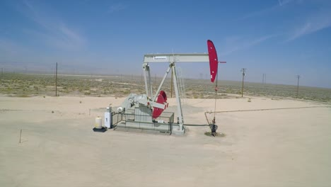 A-good-aerial-shot-beside-an-oil-pumping-derrick-near-Bakersfield-California