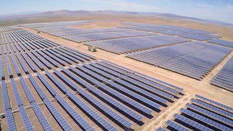 Aerial-over-a-vast-solar-array-farm-in-the-California-desert-1