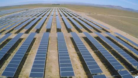 Aerial-over-a-vast-solar-array-farm-in-the-California-desert-3