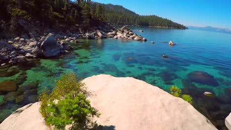 An-aerial-shot-over-beautiful-boulders-and-clear-water-in-Lake-Tahoe-Nevada-1