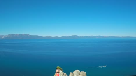 An-aerial-shot-over-a-hiker-on-a-mountaintop-in-Lake-Tahoe-Nevada-1