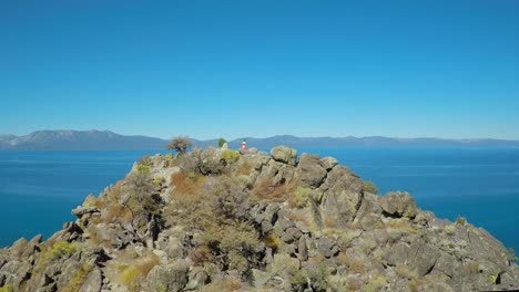 An-aerial-shot-over-a-hiker-on-a-mountaintop-in-Lake-Tahoe-Nevada-2