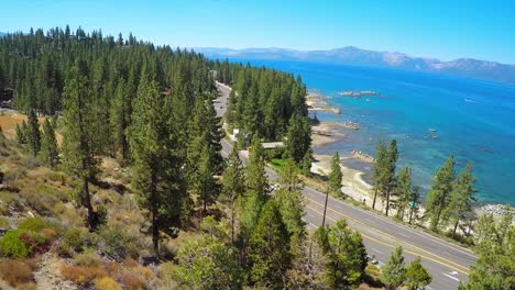 A-rising-aerial-shot-over-a-highway-running-along-the-shoreline-of-Lake-Tahoe