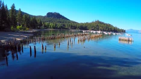 An-aerial-shot-over-old-pier-pilings-in-Glenbrook-Lake-Tahoe-Nevada-1