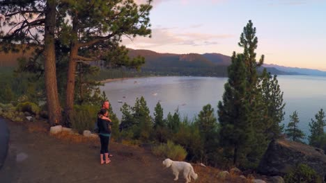 An-aerial-shot-over-a-romantic-couple-looking-out-over-Lake-Tahoe-Nevada