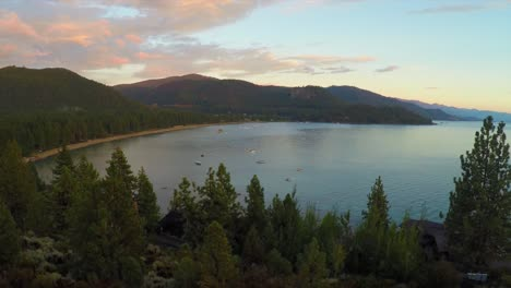 An-aerial-shot-over-a-romantic-couple-looking-out-over-Lake-Tahoe-Nevada-1