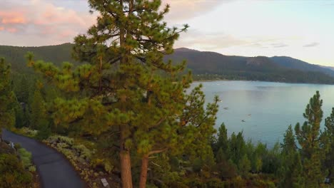 An-aerial-shot-over-a-romantic-couple-looking-out-over-Lake-Tahoe-Nevada-2