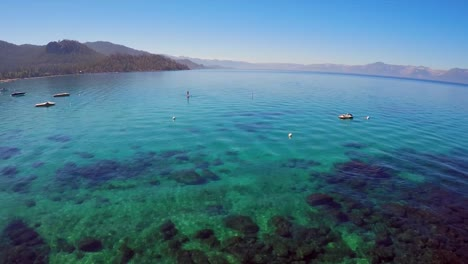 An-aerial-shot-over-a-paddle-boarder-on-Lake-Tahoe
