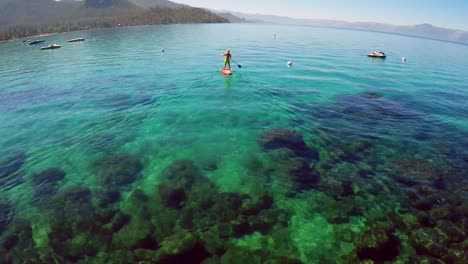 An-aerial-shot-over-a-paddle-boarder-rowing-on-Lake-Tahoe-1
