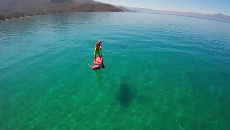 An-aerial-shot-over-a-paddle-boarder-rowing-on-Lake-Tahoe-2