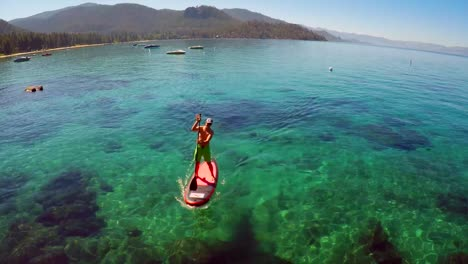 An-aerial-shot-over-a-paddle-boarder-rowing-on-Lake-Tahoe-3