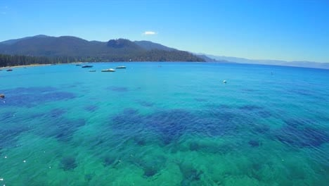 An-aerial-shot-of-a-woman-and-man-sitting-on-a-paddle-board-on-Lake-Tahoe-1