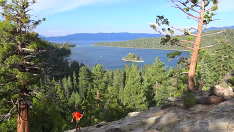 A-hiker-crosses-in-front-of-Emerald-Bay-at-Lake-Tahoe