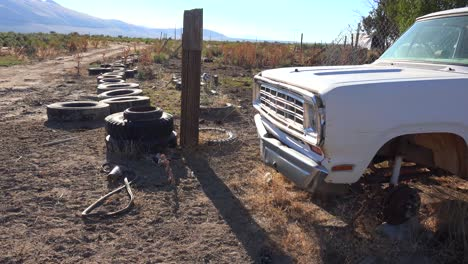 Old-abandoned-pickup-truck-int-he-desert-and-tires-strewn-about
