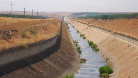 Irrigation-canals-are-dry-in-California-during-a-drought-1