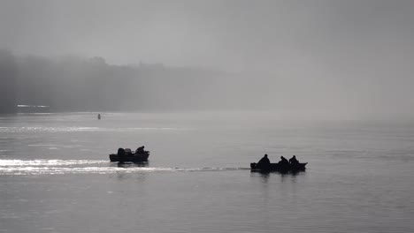 Fishing-boats-head-out-on-a-foggy-morning-along-the-Mississippi-River-1