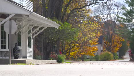 An-attractive-old-weathered-garage-along-a-rural-road-in-America-with-fall-colors