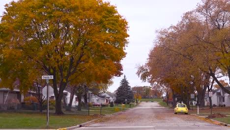 Panning-shot-of-a-Green-bay-Wisconsin-neighborhood-reveals-Lambeau-Field