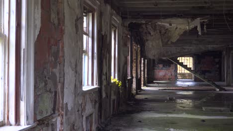 Pan-across-the-abandoned-and-spooky-interior-of-old-boarding-school-or-mansion-in-the-countryside