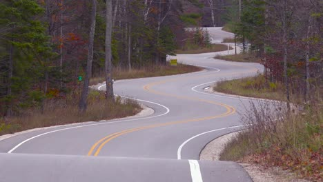 A-curvy-and-winding-empty-road-meanders-through-a-forest