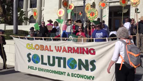 Global-warming-protestors-walk-on-a-city-street