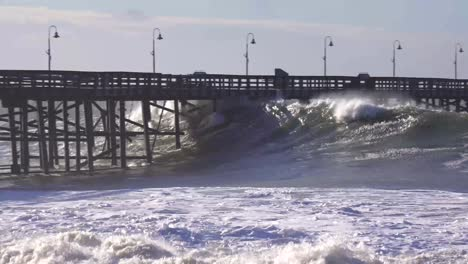 Huge-waves-crash-on-a-California-beach-and-pier-during-a-very-large-storm-event-1