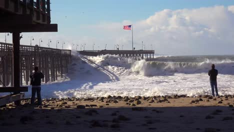 Huge-waves-crash-on-a-California-beach-and-pier-during-a-very-large-storm-event-11