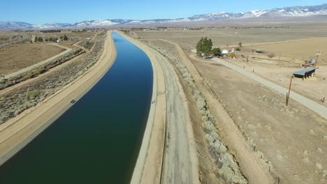 Aerial-pan-up-over-the-California-aqueduct-delivering-water-to-a-drought-stricken-state-1