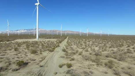 A-good-rising-aerial-over-a-Mojave-desert-wind-farm-as-it-generates-clean-energy-for-California