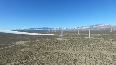 A-good-eye-level-aerial-over-a-Mojave-desert-wind-farm-as-it-generates-clean-energy-for-California