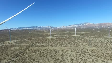 A-good-eye-level-aerial-over-a-Mojave-desert-wind-farm-as-it-generates-clean-energy-for-California-1