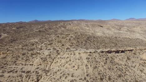 An-aerial-over-a-beautiful-dry-cliff-face-in-the-remote-Mojave-Desert-of-California-or-Nevada-1
