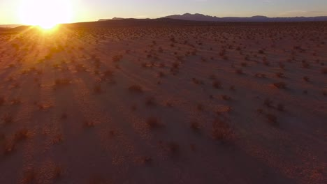 A-beautiful-fast-moving-low-aerial-over-the-Mojave-desert-at-sunrise-or-sunset-2