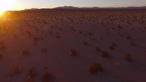 A-beautiful-fast-moving-low-aerial-over-the-Mojave-desert-at-sunrise-or-sunset-4