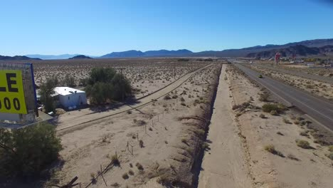 A-billboard-advertises-a-large-tract-of-land-in-the-desert-for-sale-and-ready-for-development