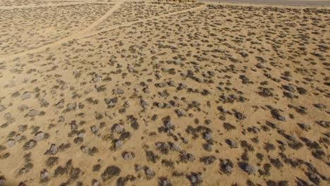 Aerial-tilt-up-over-a-lonely-desert-community-in-the-Mojave-Desert-of-California-1