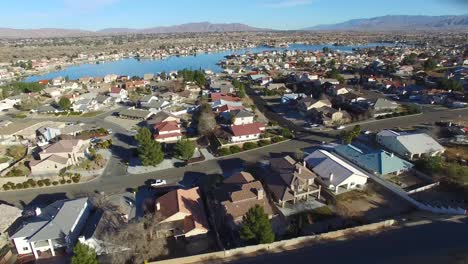 Aerial-over-a-suburban-neighborhood-in-the-desert-with-an-artificial-lake