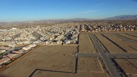Aerial-over-desert-reveals-housing-tracts-in-the-desert