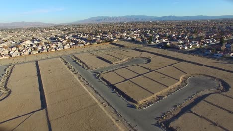 Aerial-over-desert-reveals-housing-tracts-and-empty-lots-in-the-desert