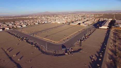 Aerial-over-desert-reveals-housing-tracts-and-empty-lots-in-the-desert-1