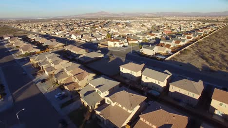 Aerial-over-vast-desert-housing-tracts-suggests-suburban-sprawl-1
