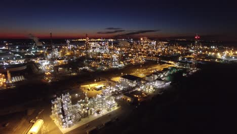 Excellent-aerial-over-huge-industrial-oil-refinery-at-night