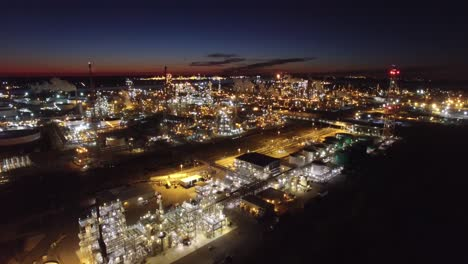Excellent-aerial-over-huge-industrial-oil-refinery-at-night-1