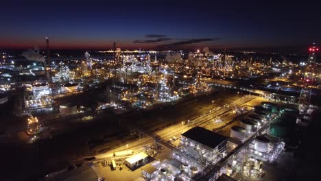Excellent-aerial-over-huge-industrial-oil-refinery-at-night-2