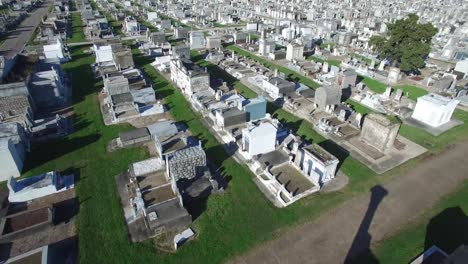 Haunting-low-aerial-shot-over-a-New-Orleans-cemetery-with-raised-gravestones