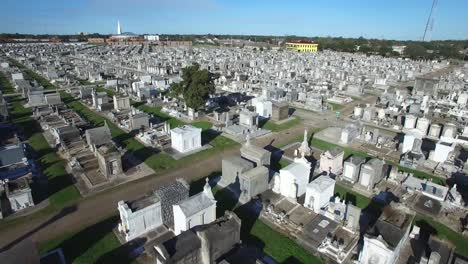 Haunting-low-aerial-shot-over-a-New-Orleans-cemetery-with-raised-gravestones-1