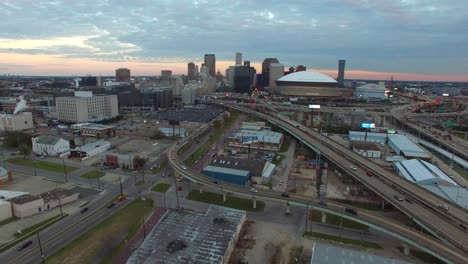 High-angle-vista-aérea-shot-reveals-the-New-orleans-Louisiana-skyline-with-Superdome-in-foreground